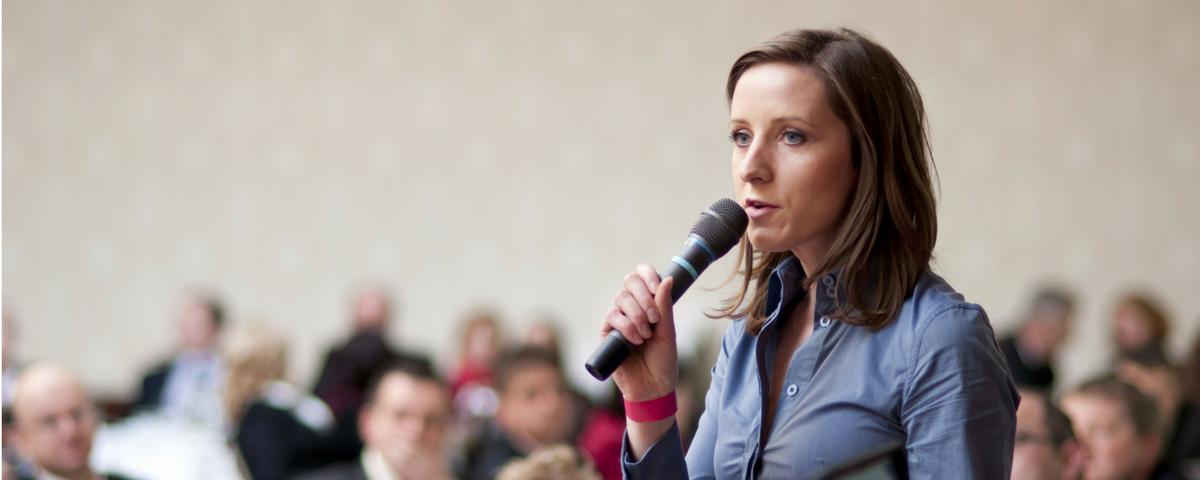Woman speaking to conference meeting